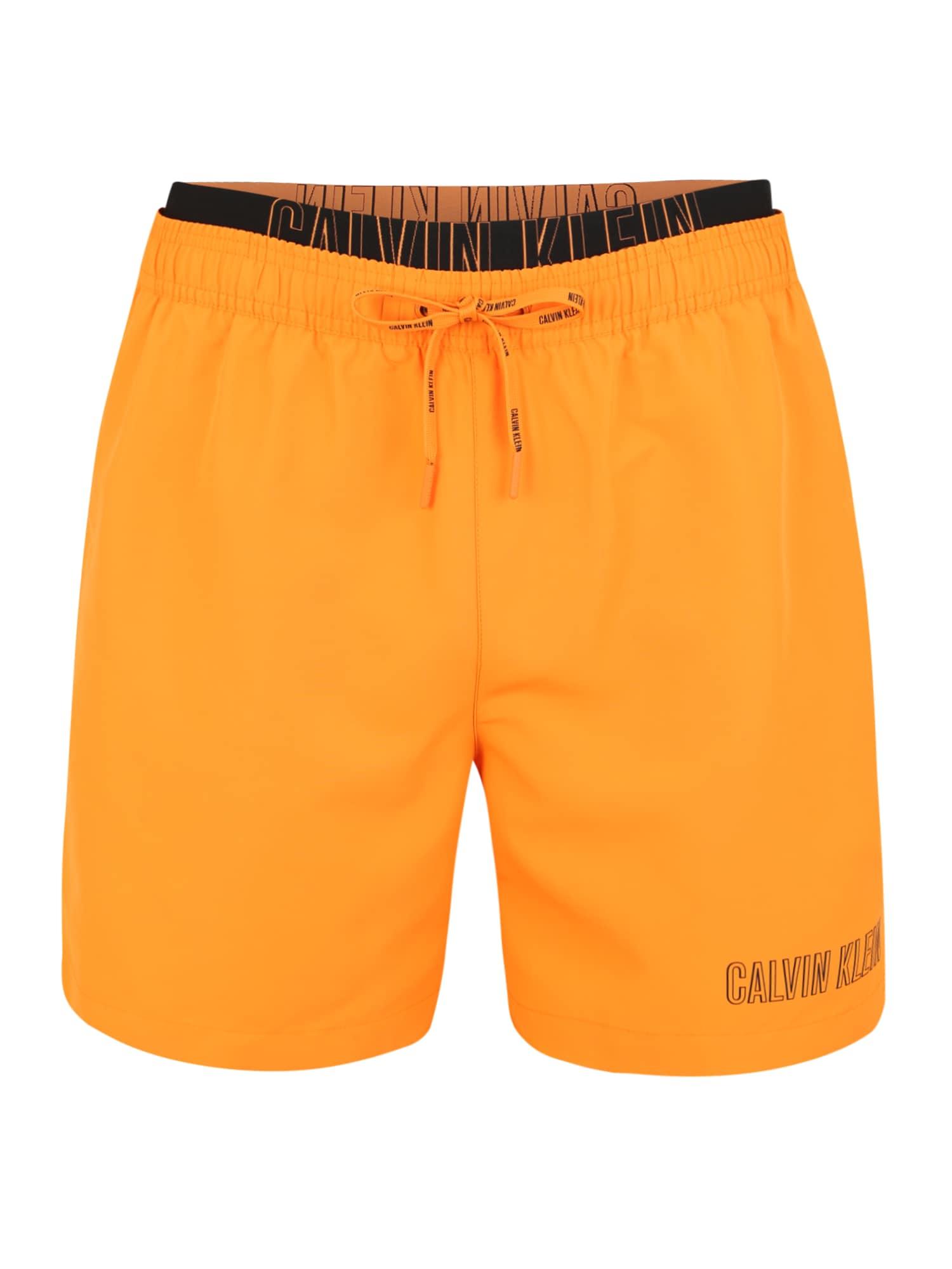 Plavecké šortky MEDIUM DOUBLE WAISTBAND zlatě žlutá Calvin Klein Swimwear