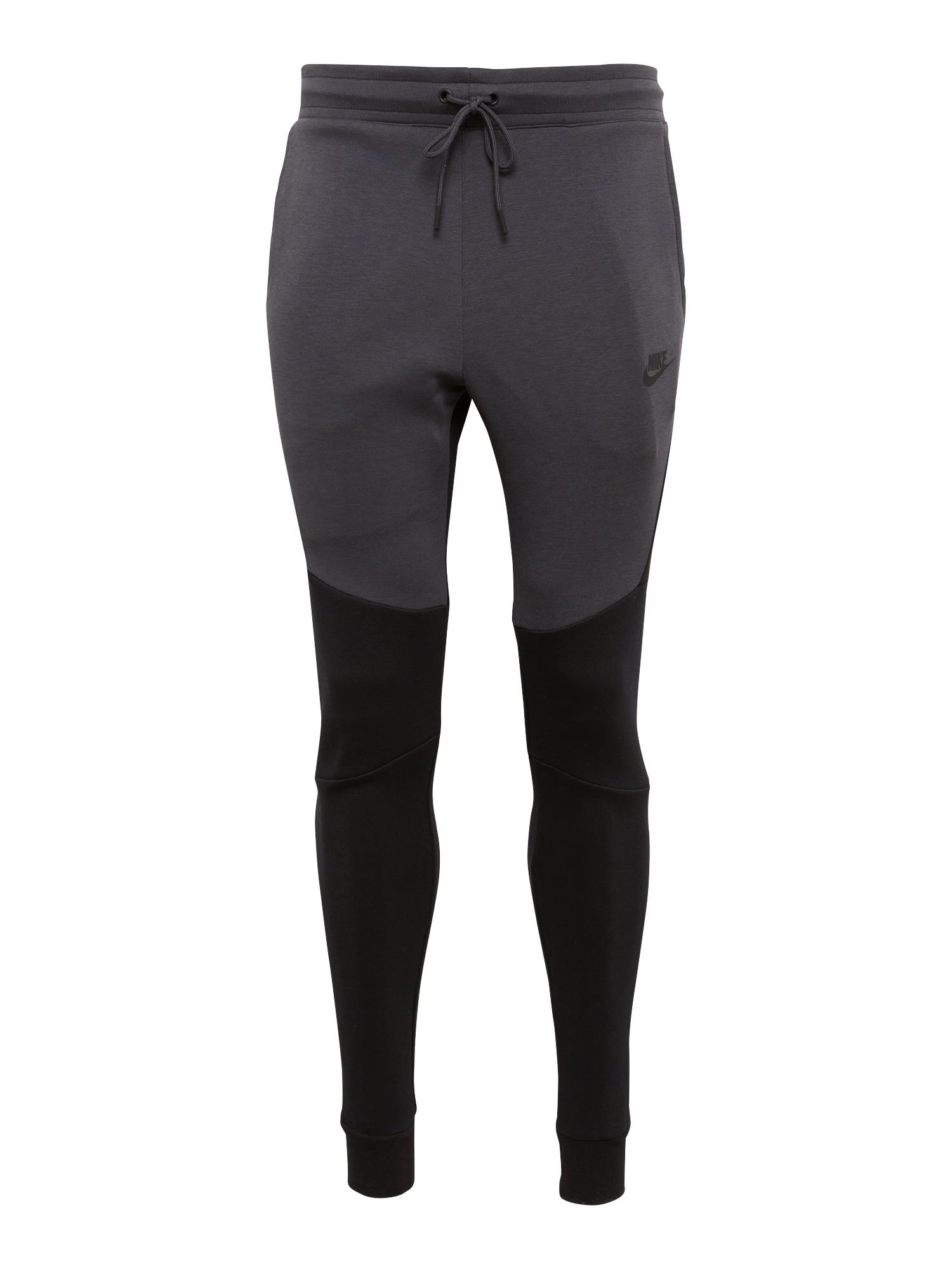 Kalhoty tmavě šedá černá Nike Sportswear