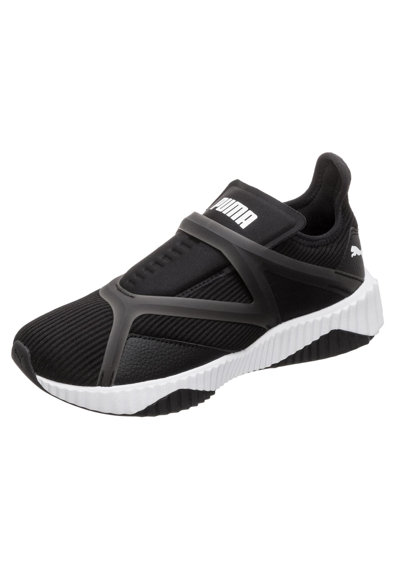 PUMA, Dames Sneakers laag 'Defy Cage', zwart / wit
