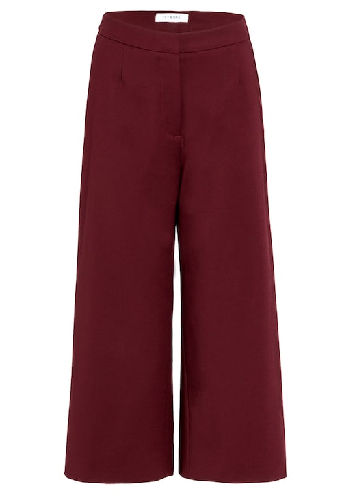 Die elegante Culotte ist ein Must Have im Kleiderschrank. Mit ihrem weiten Schnitt und der cropped Länge definiert sie eine moderne Shape ohne den Business-Anspruch zu verlieren. Durch den elastischen Stoff ist Bewegungsfreiheit gegeben, die