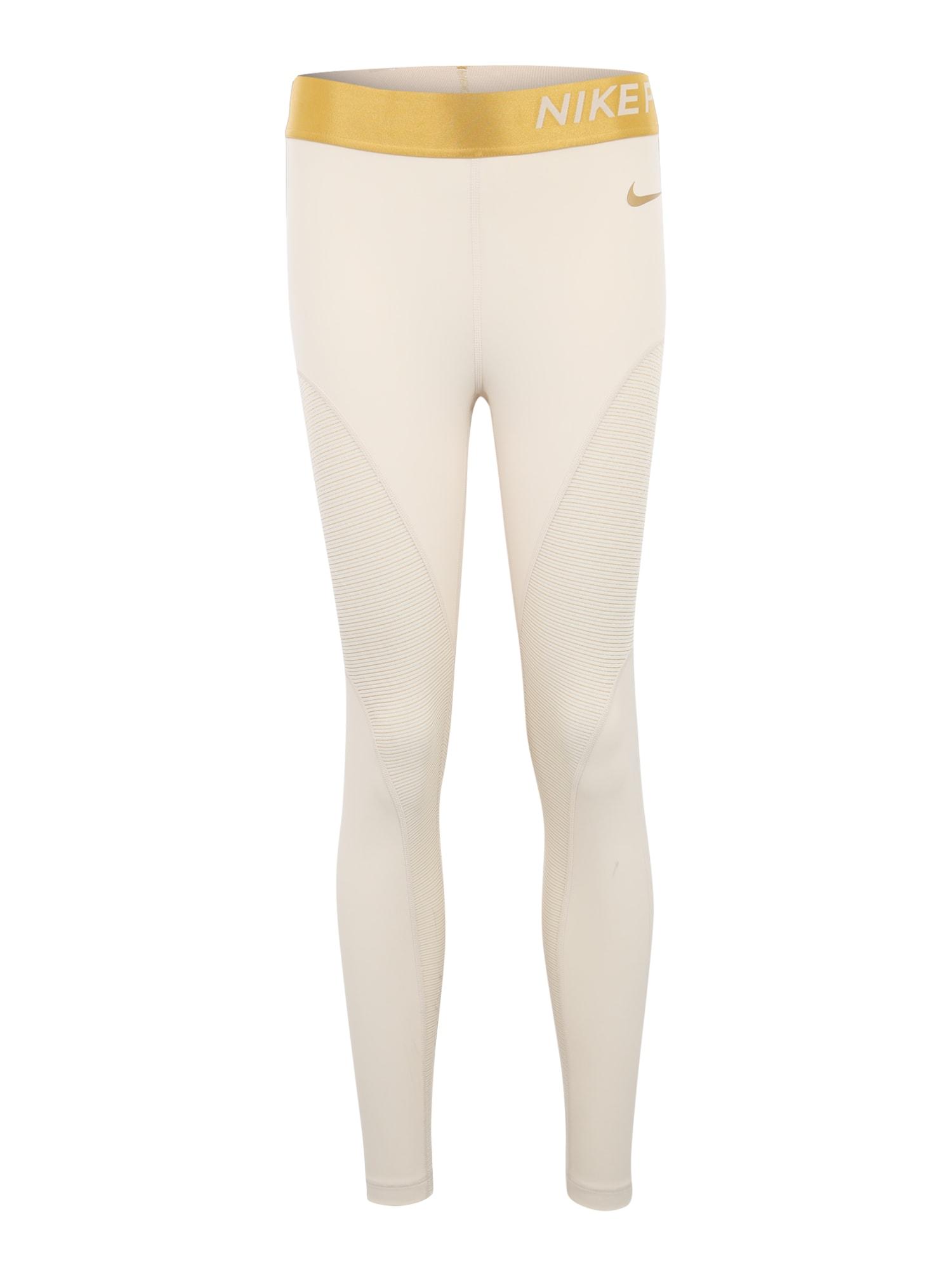 Sportovní kalhoty CHAMPAGNE krémová NIKE
