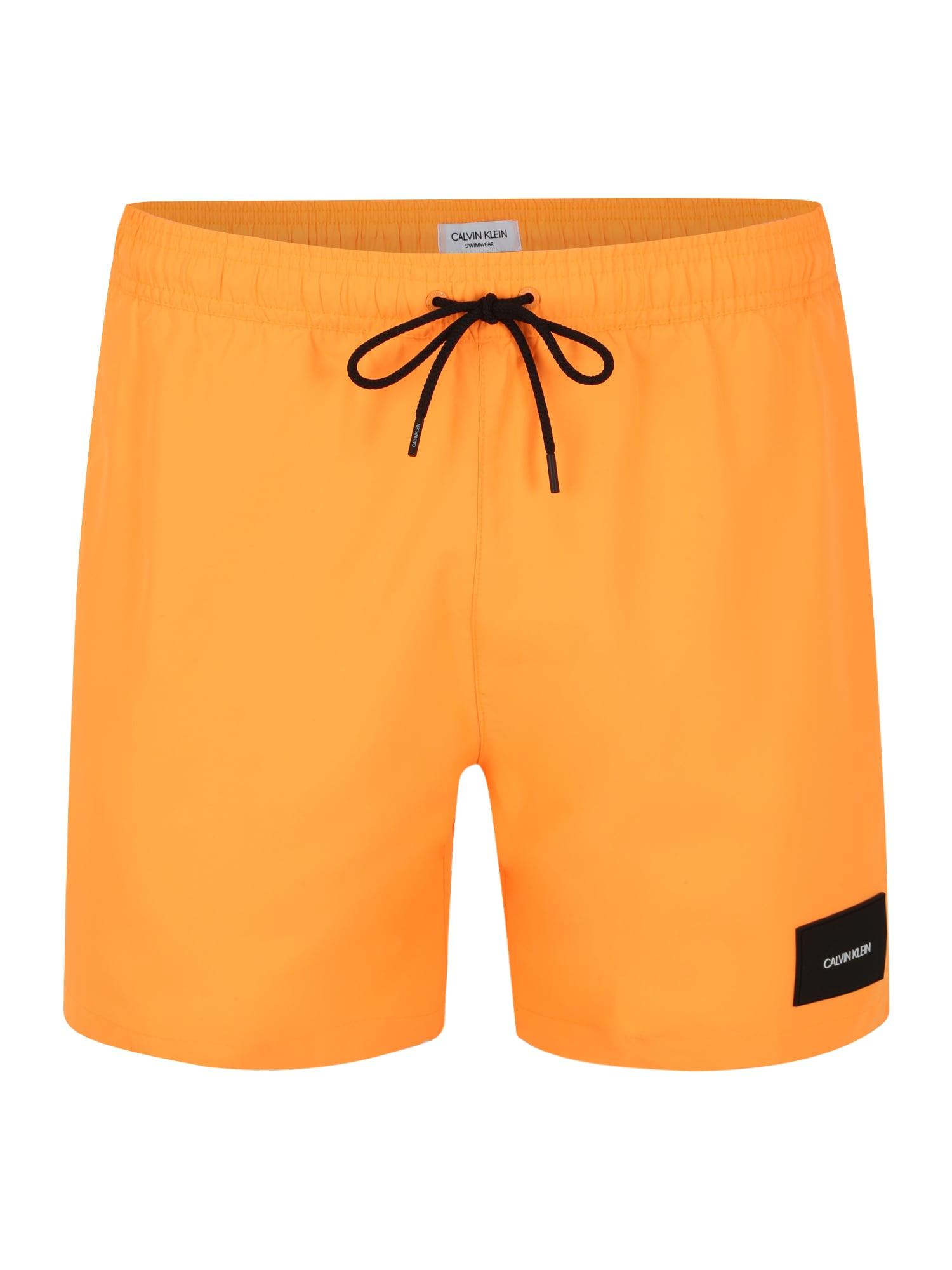 Calvin Klein Swimwear Maudymosi trumpikės 'MEDIUM DRAWSTRING' oranžinė