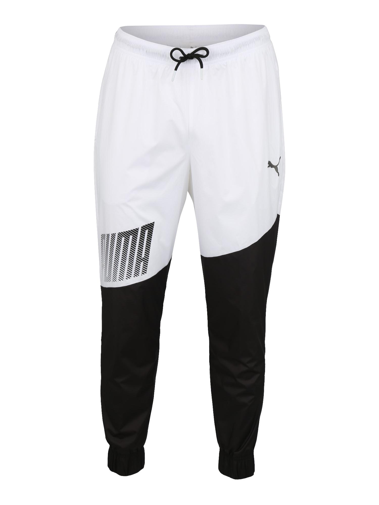 PUMA Sportovní kalhoty 'A.C.E. Trackster'  bílá / černá