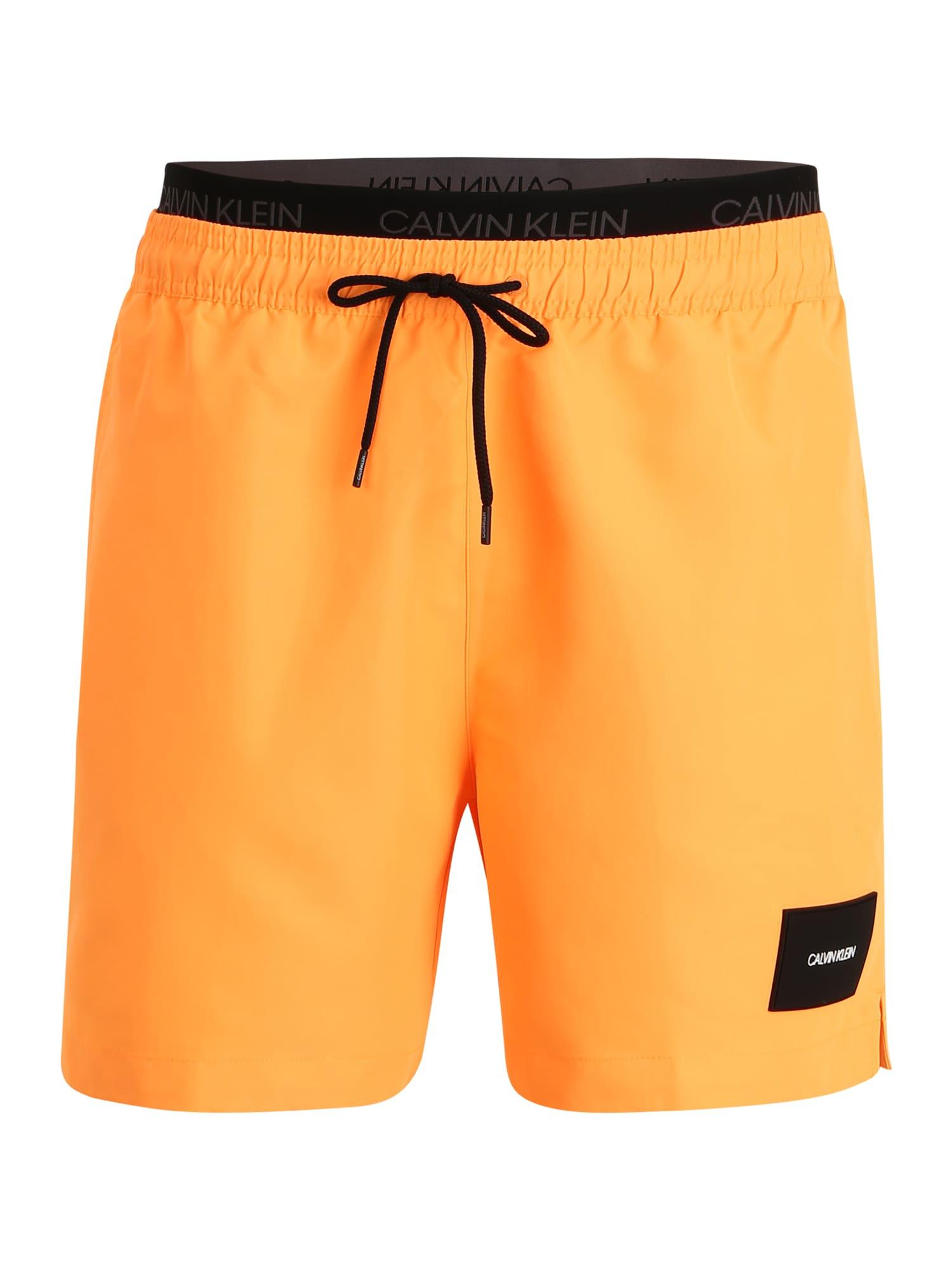 Calvin Klein Swimwear Maudymosi trumpikės oranžinė / juoda