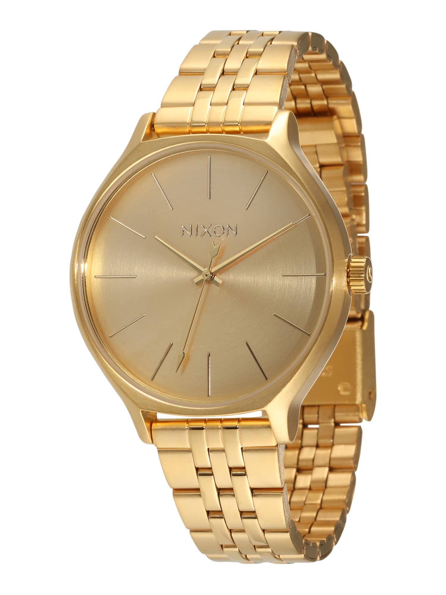 Analogové hodinky Clique zlatá Nixon