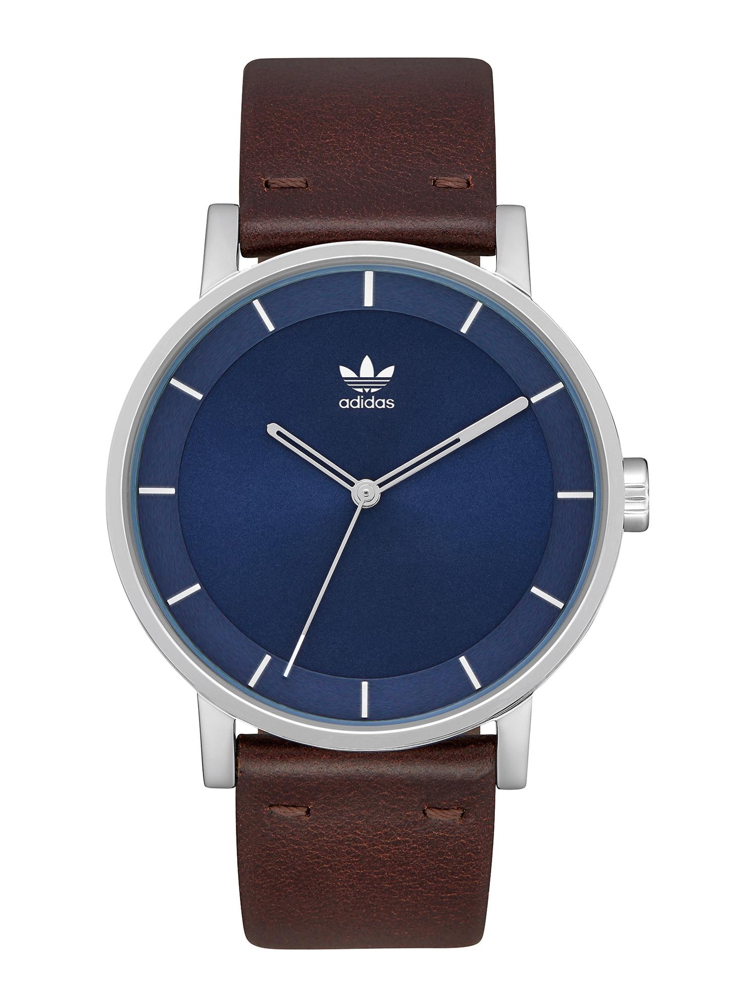 ADIDAS ORIGINALS Analoginis (įprastinio dizaino) laikrodis 'District L1' sidabras / mėlyna / tamsiai ruda