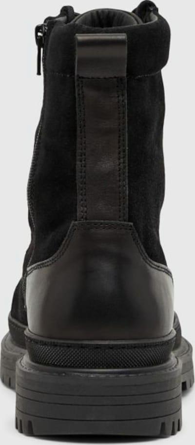 - Runde Schuhspitze - Schnürung vorn - Seitlicher Reißverschluss - Obermaterial aus Wildleder - Fersenlasche - Flache Sohle mit Profil