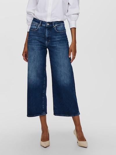 - Weite Jeans - Frontverschluss - Five-Pocket-Style - Gürtelschlaufen - Knöchellänge - Dehnbares Material - Schritthöhe: 70 cm in Größe 28/34 - Das Model trägt Größe S