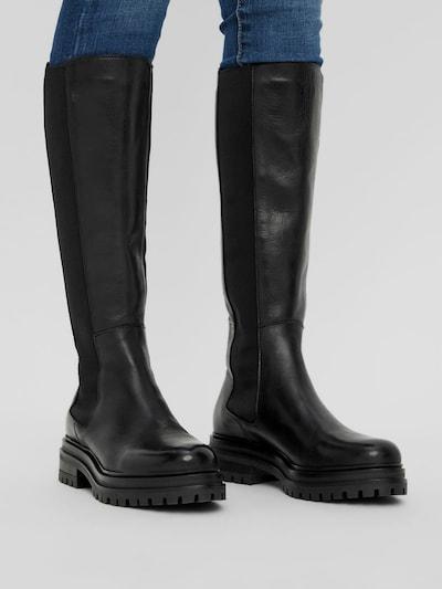 - Runde Schuhspitze - Elastische Seiteneinsätze - Fersenlasche - Halbe Wadenlänge - Laufsohle mit Profil