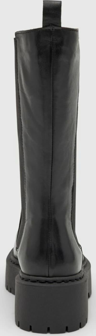- Runde Schuhspitze - Obermaterial aus Leder - Elastische Seiteneinsätze - Futter aus Kunstfell - Fersenlasche - Chunky-Sohle mit Profil - Absatzhöhe: 3,5 cm