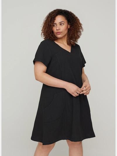Kleid von Zizzi.  Schönes, schlichtes Kleid mit lockerer A-Linie aus 100% Baumwolle. Das Kleid hat kurze Ärmel, einen V-Ausschnitt und Taschen vorne.