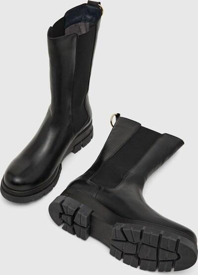- Runde Schuhspitze - Obermaterial aus Leder - Elastische Seiteneinsätze - Fersenlasche - Laufsohle mit Profil - Chunky-Sohle