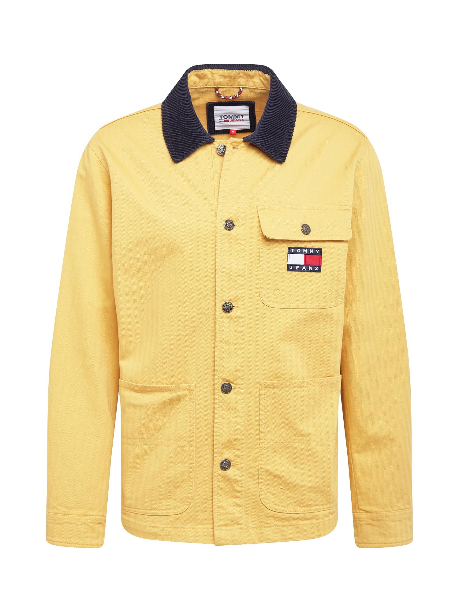 Tommy Jeans Demisezoninė striukė garstyčių spalva / tamsiai mėlyna jūros spalva