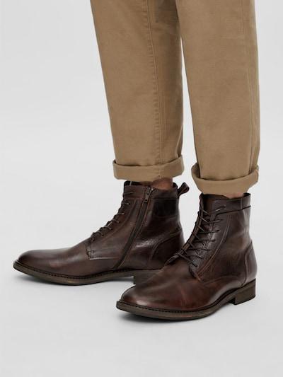- Mandelförmige Schuhspitze - Schnürung vorn - Seitlicher Reißverschluss - Fersenlasche - Nahtdetails - Niedriger Absatz